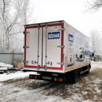 Брендирование ворот грузовика